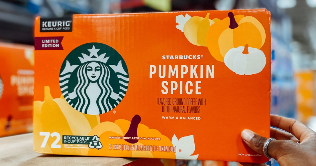 hand holding box with Starbucks pumpkin spice flavored coffee