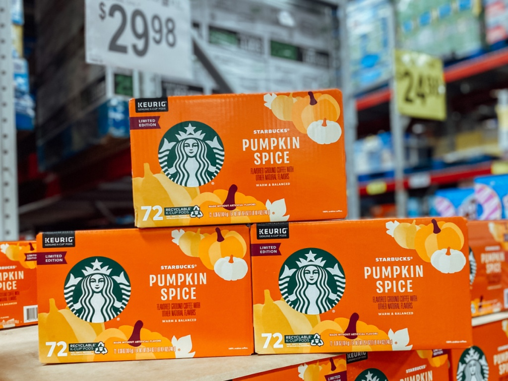 stacks of boxes in store containing Starbucks kcups