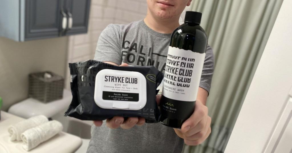 stryke club skincare in boys hands