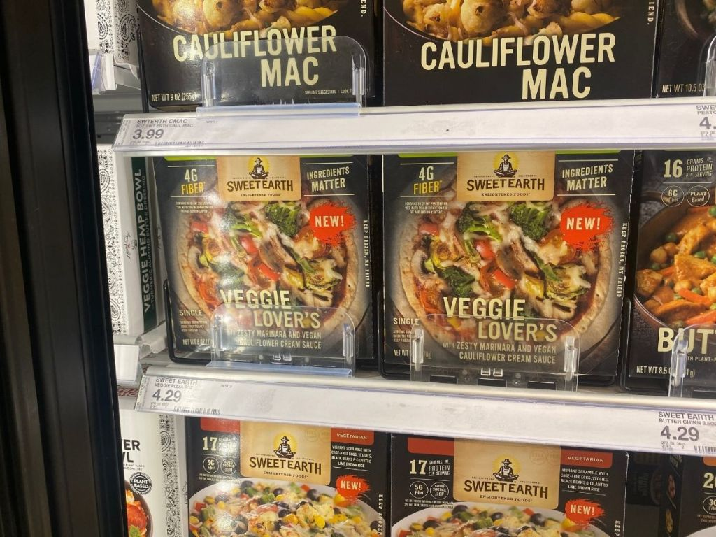 grocery store fridge filled with Sweet Earth veggie lovers frozen dinners