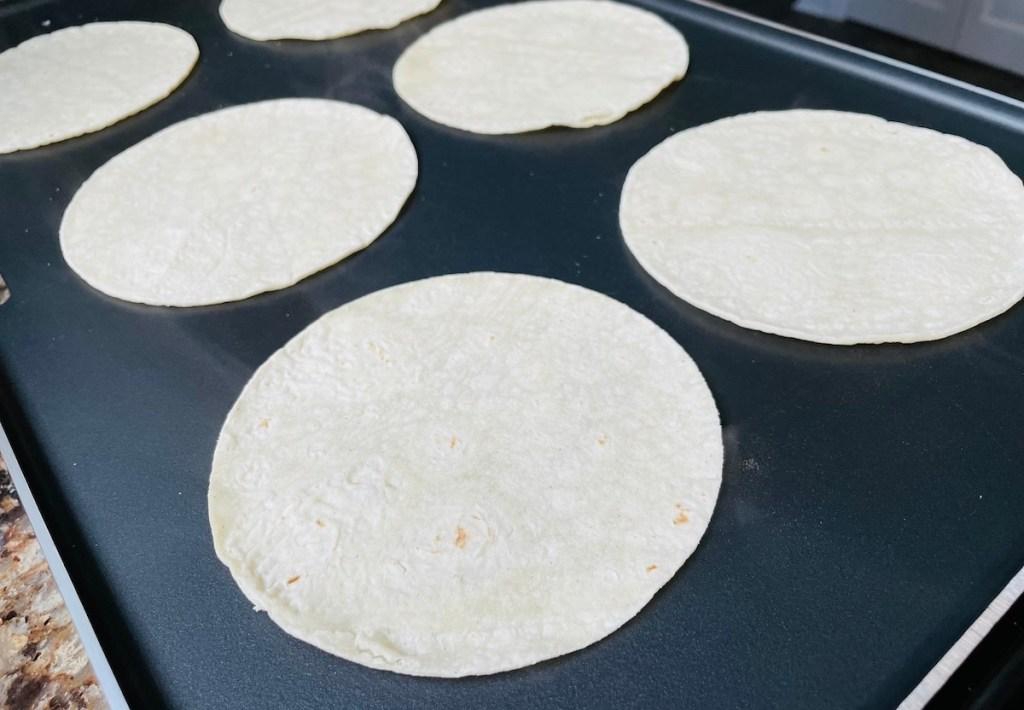 tortillas on griddle