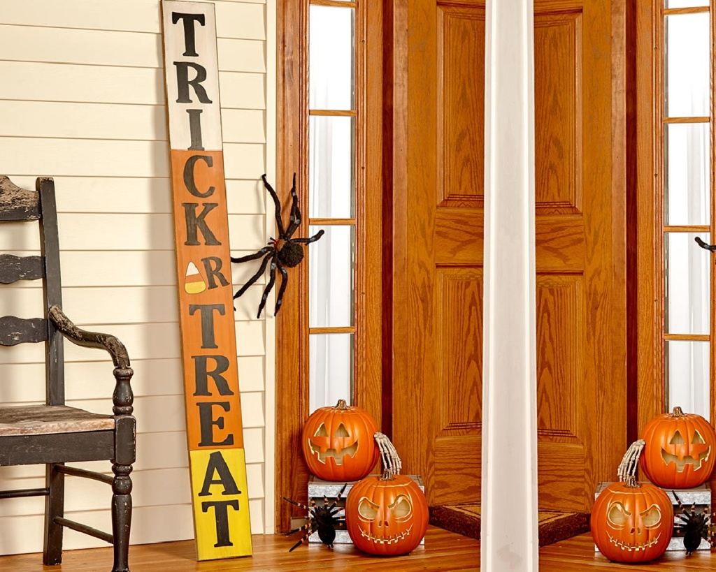 trick or treat porch sign near door