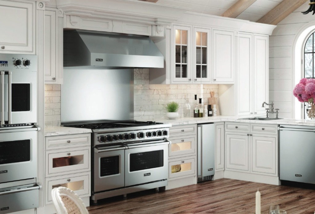 white kitchen with stainless appliances