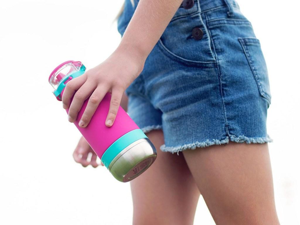 kid holding pink water bottle