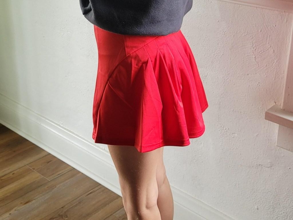 woman wearing red tennis skirt