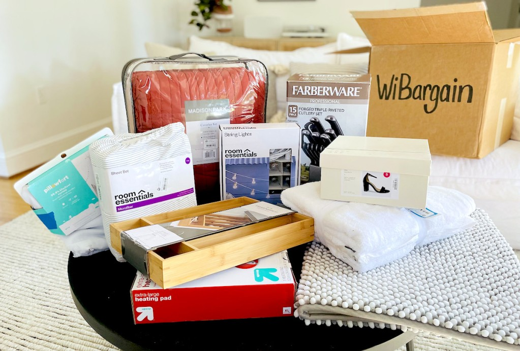 various home items on coffee table with wibargain box in background