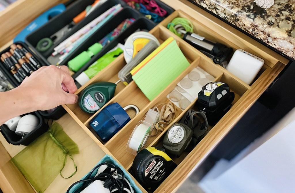 hand holding drawer organizer