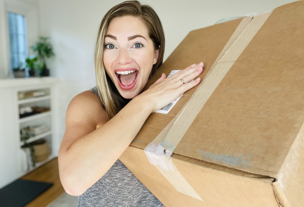 woman holding delivery box with mouth open