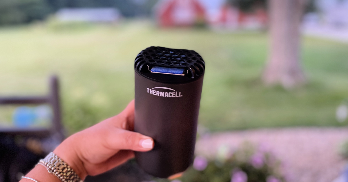 woman holding a thermacell mosquito repellent
