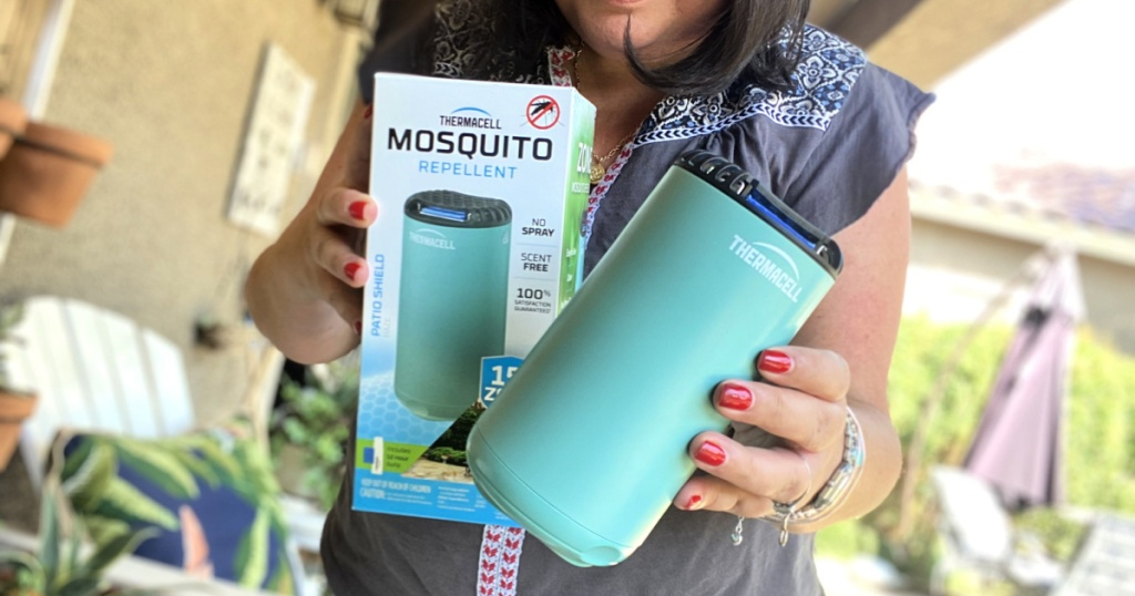 woman holding a thermacell patio shield mosquito repellent