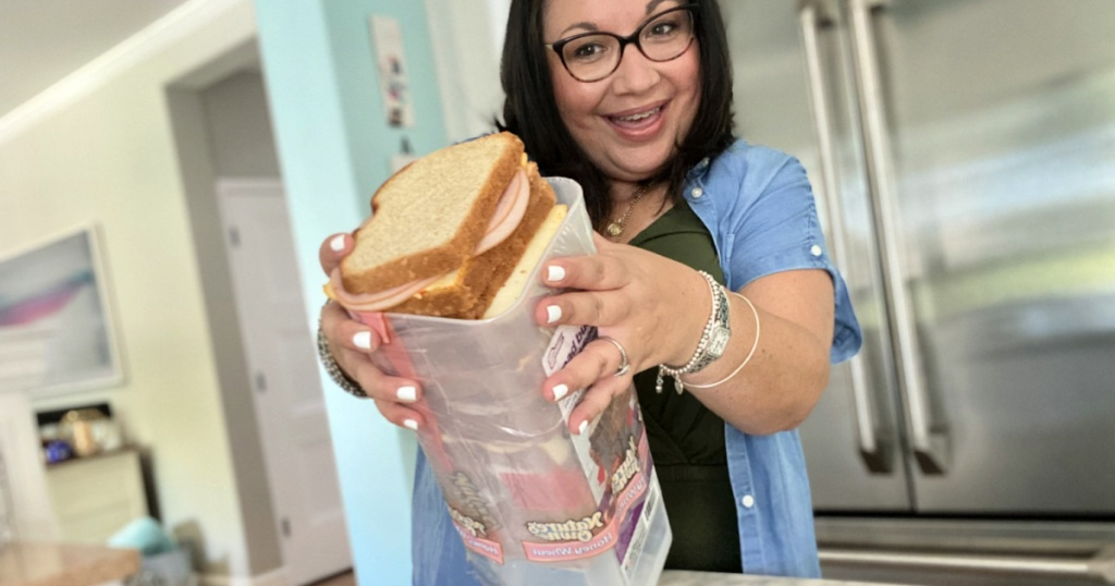 woman holding sandwich dispenser