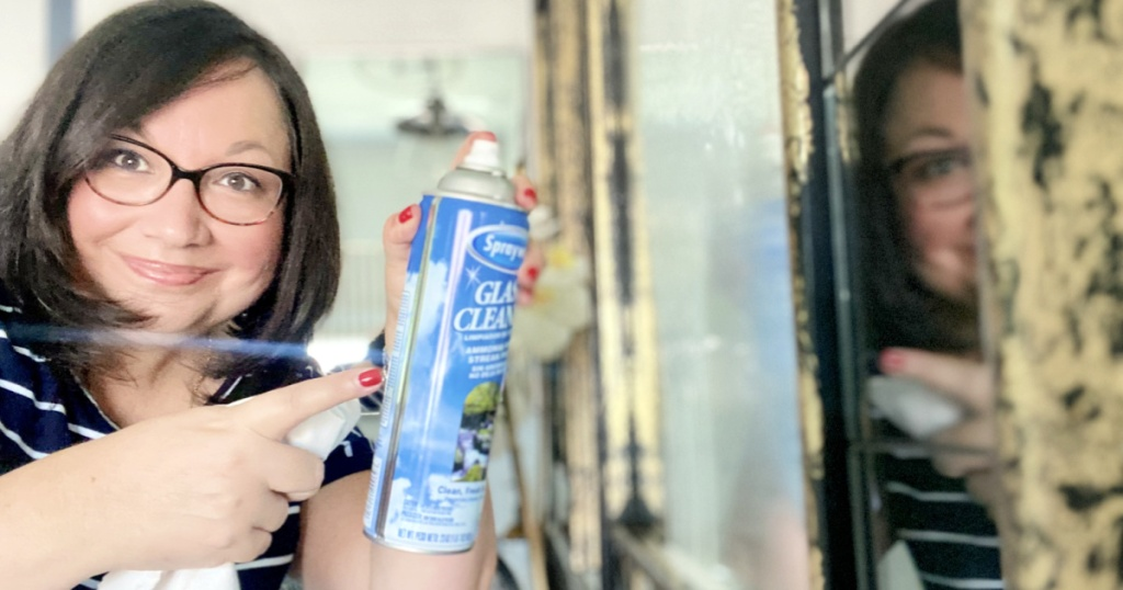 woman pointing to sprayway glass cleaner