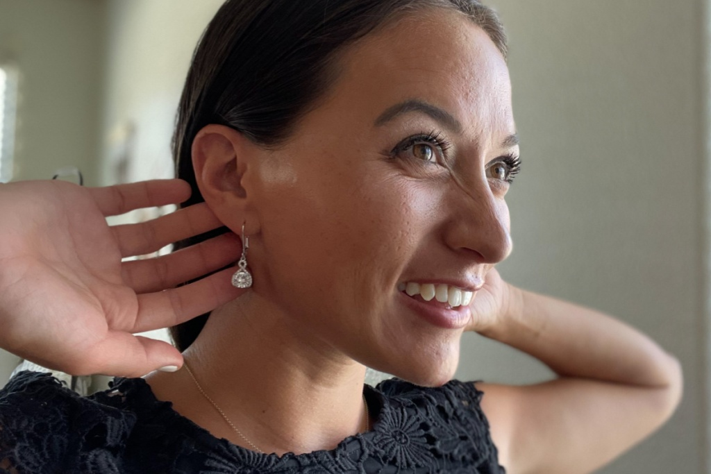 woman wearing cate & chloe earrings