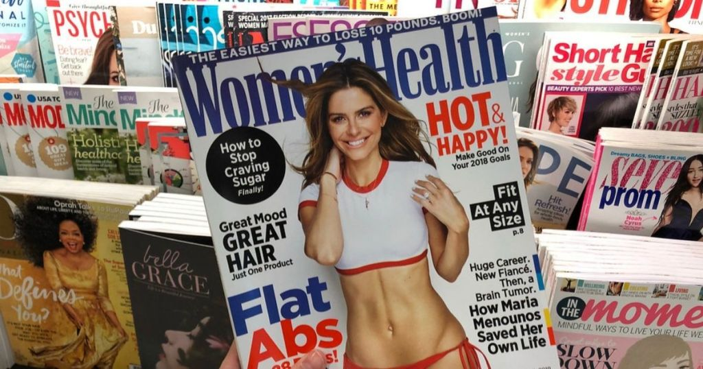 Women's Health magazine in front of magazine rack