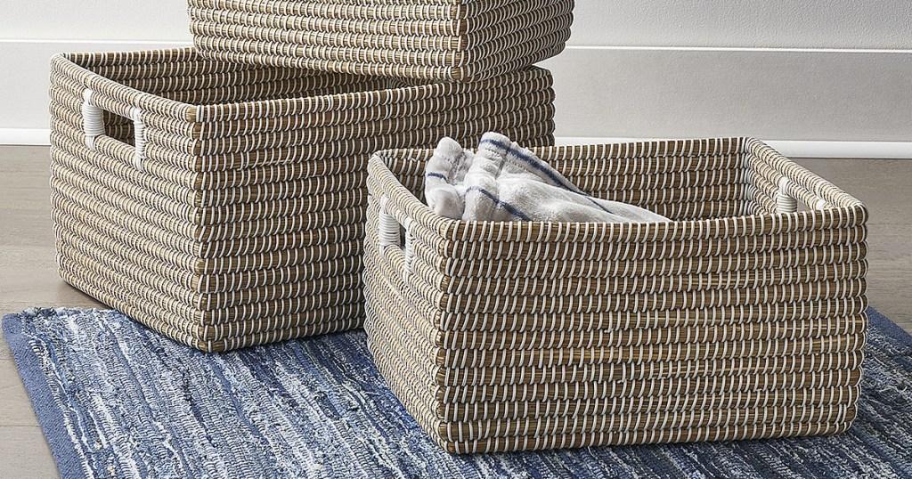tan baskets on blue floor mat