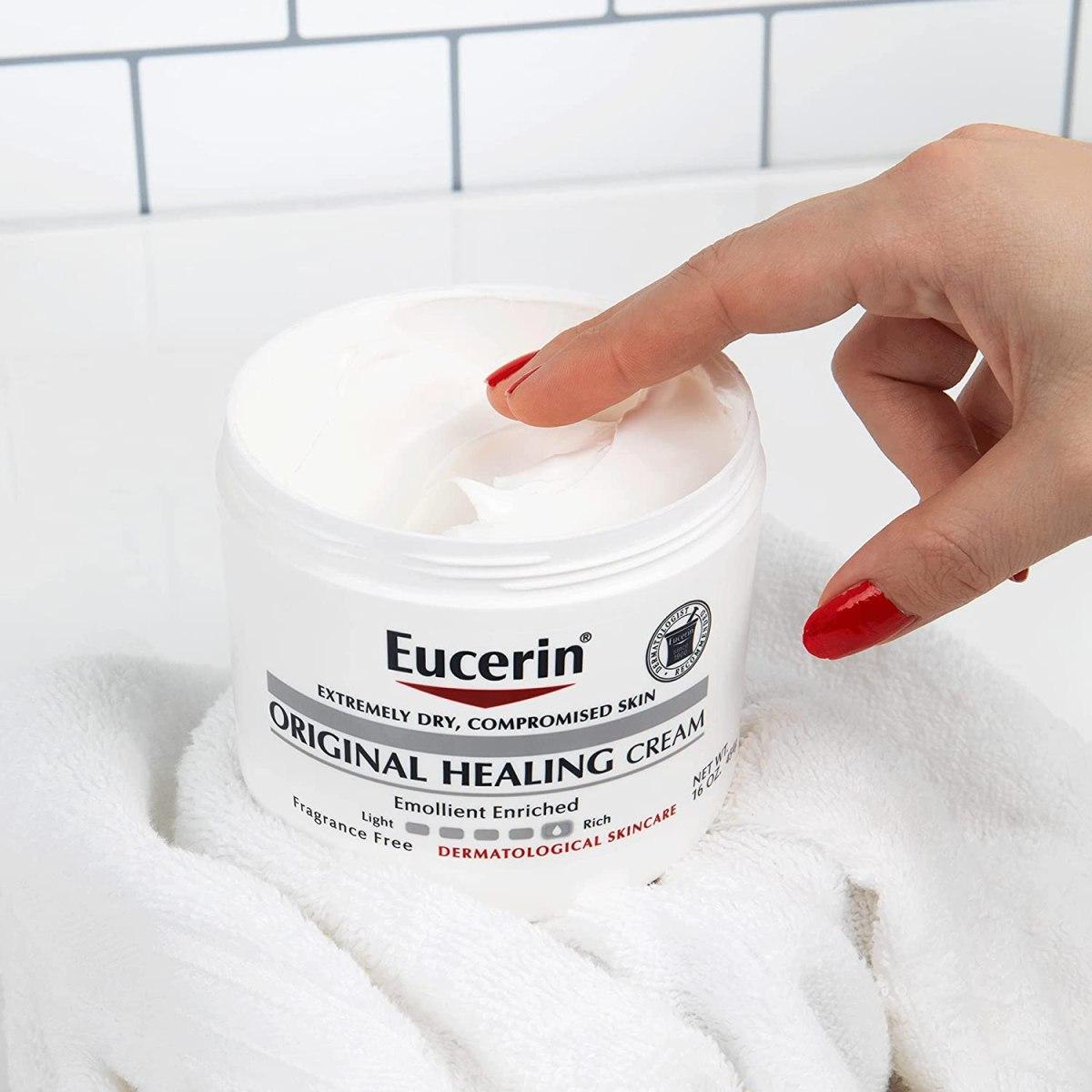 womans finger in Eucerin jar