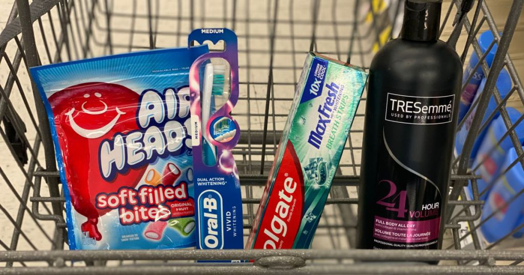 candy, shampoo, toothpaste and toothbrushes in basket