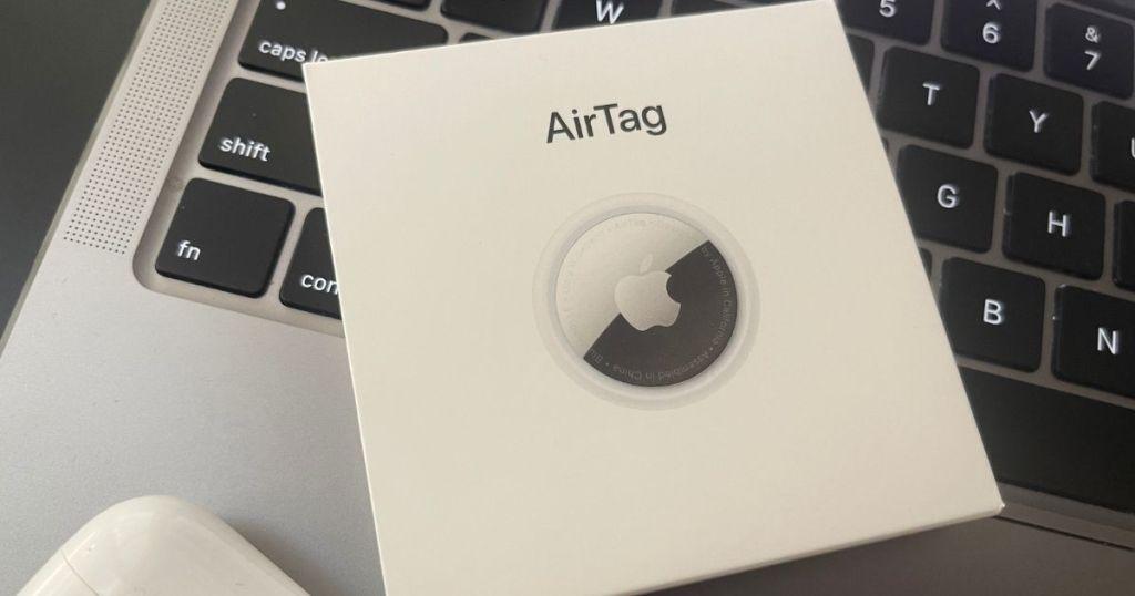 Apple AirTag box sitting on a laptop