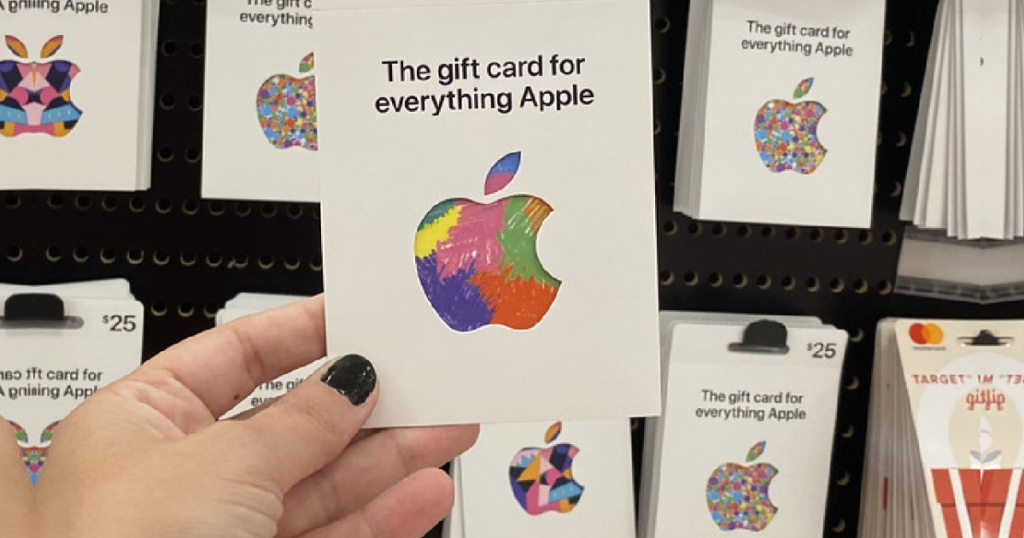 hand holding an apple gift card