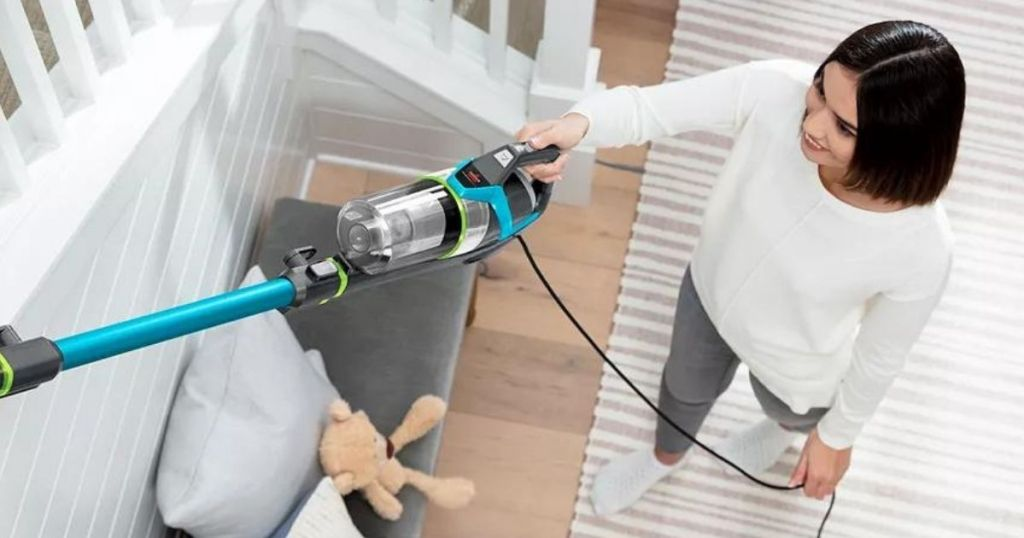 woman holding a vacuum