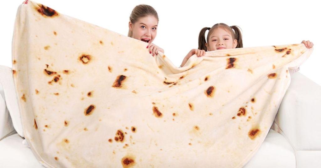 people pretending to eat a burrito blanket