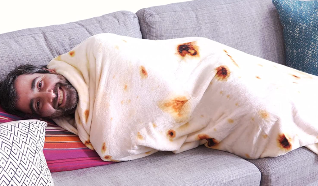 man wrapped up in a burrito blanket