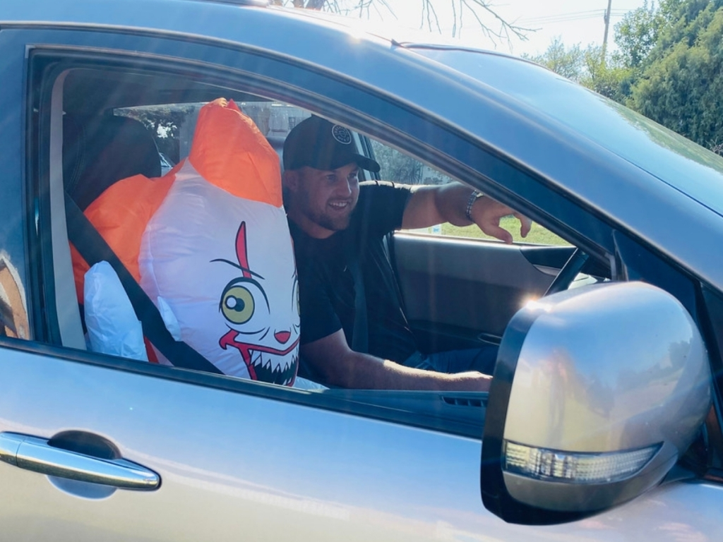 man in car with inflatable Pennywise Clown (1)
