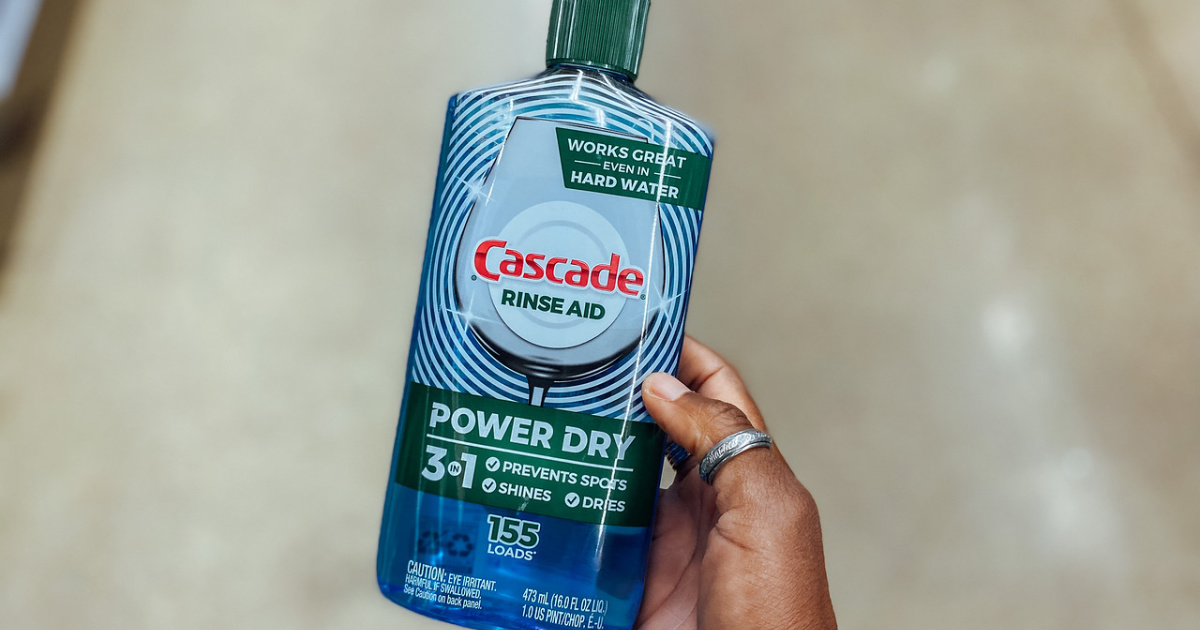 Hand holding Cascade Power Dry Rinse Aid
