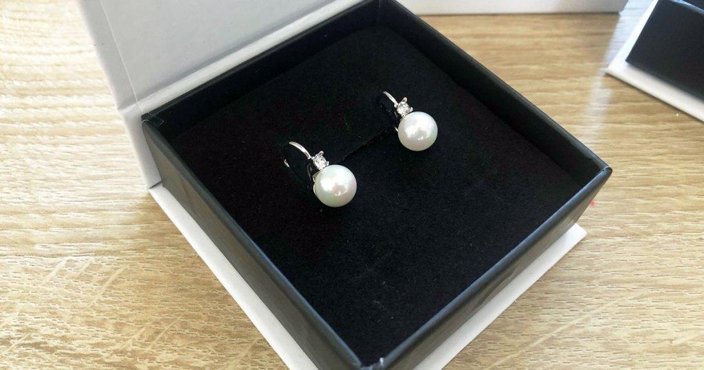 pair of pearl earrings in a box