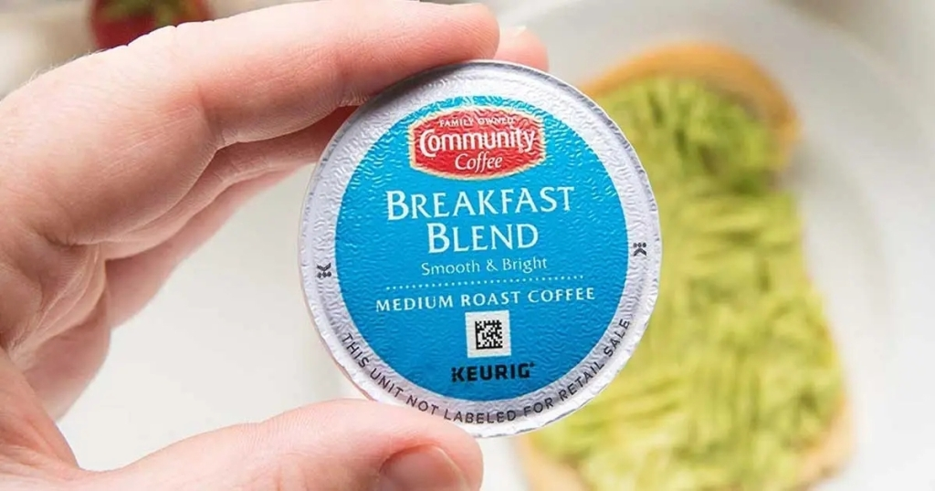 hand holding community coffee breakfast blend k cup