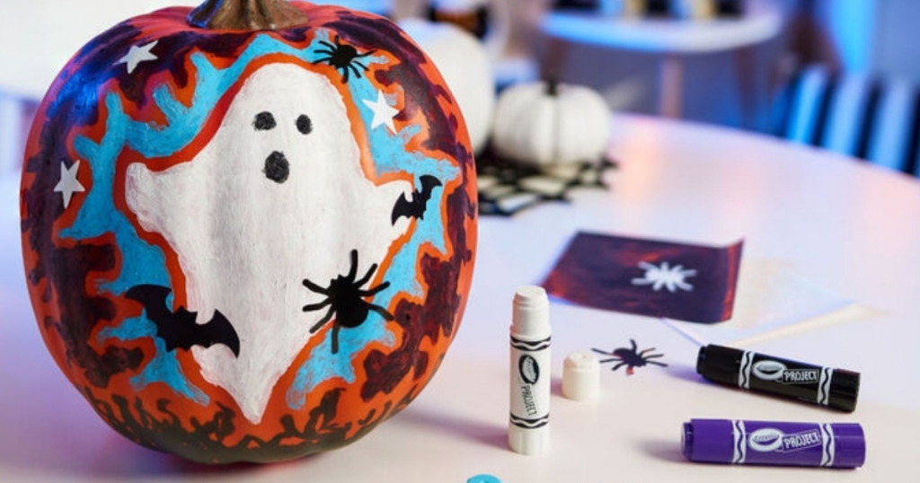 crayola pumpkin painting kit with decorated pumpkin and painters