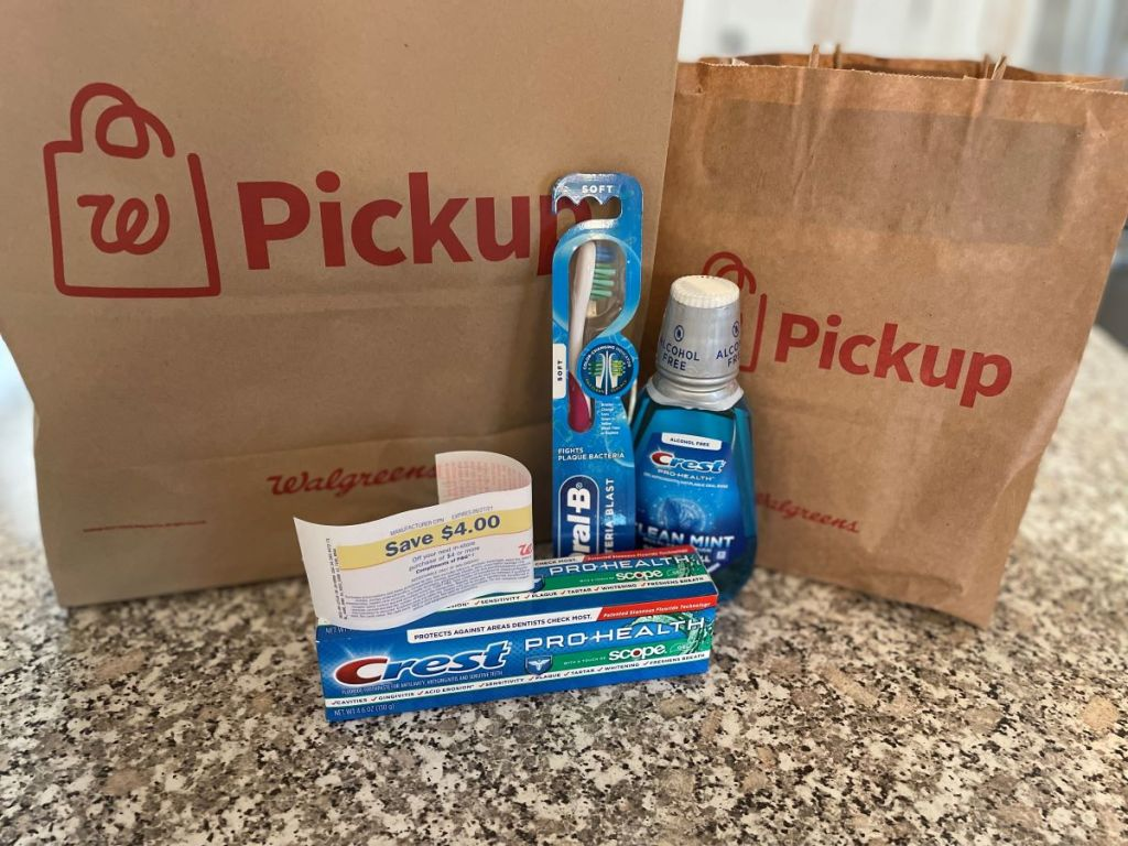 Crest and Oral-B products by a Walgreens bag