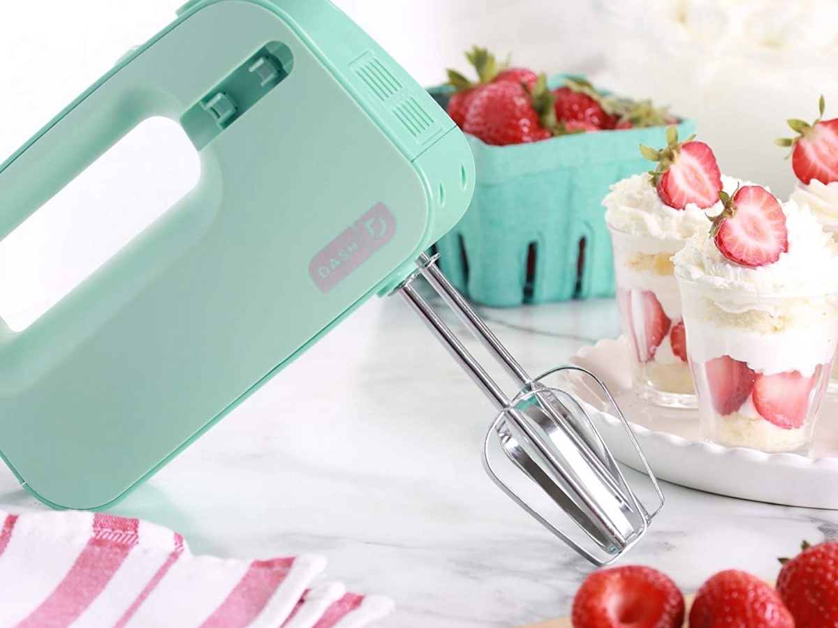 mint colored dash hand mixer with strawberries