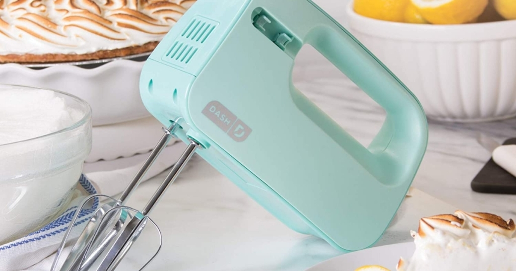 dash hand mixer in mint on counter