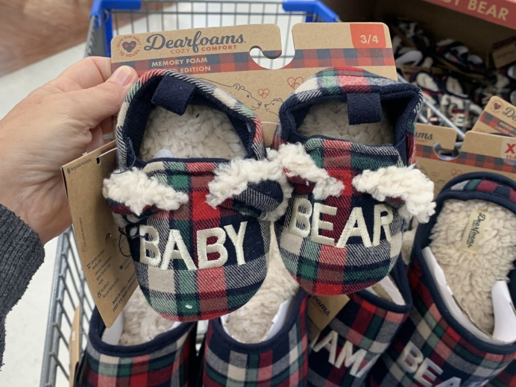 hand holding dearfoams baby bear slippers in store