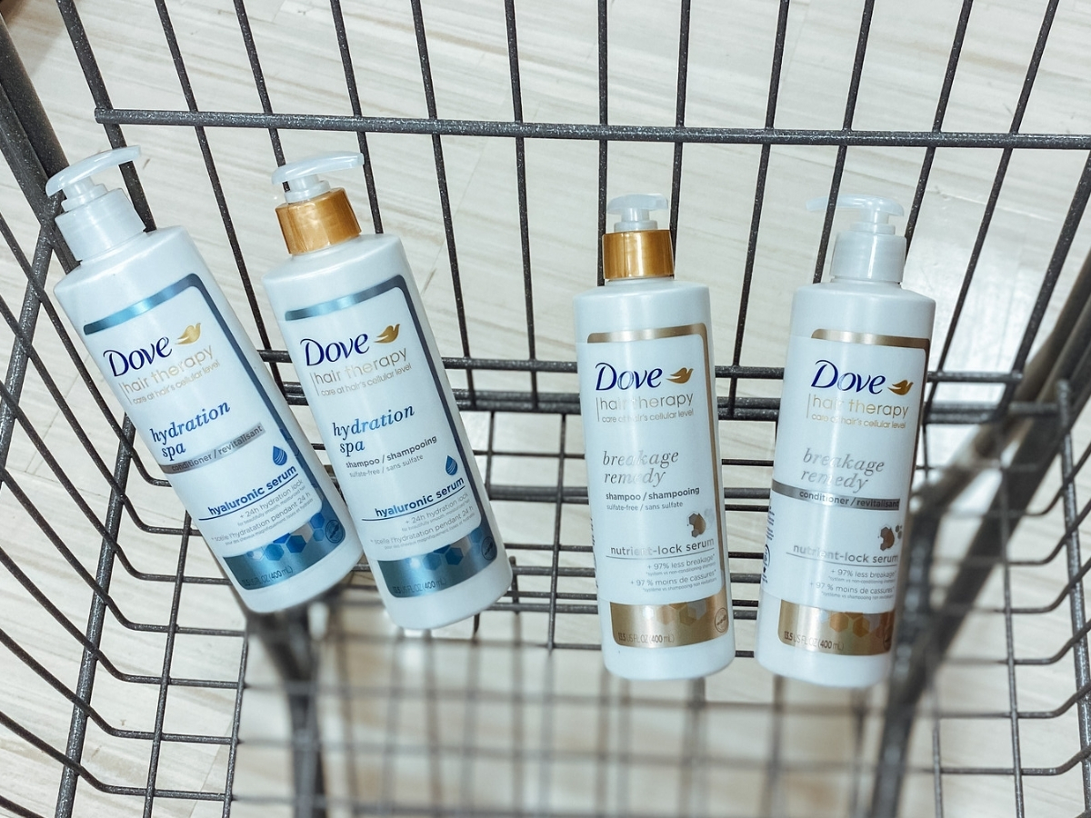 4 bottles of dove hair therapy in store