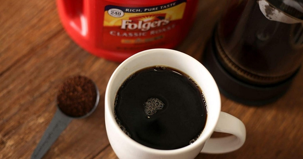 folger's large canister of coffee and coffee cup