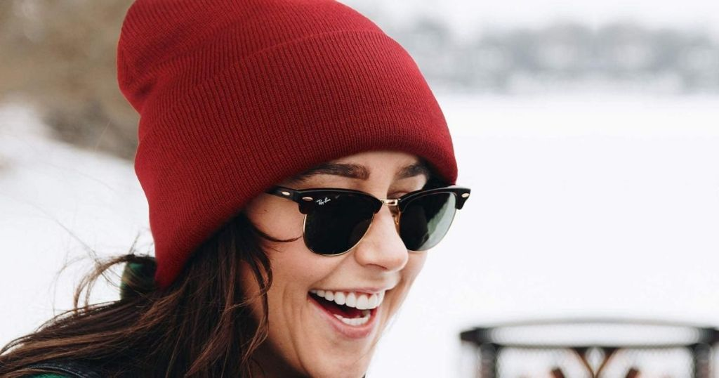 woman wearing a red beanie and sunglasses