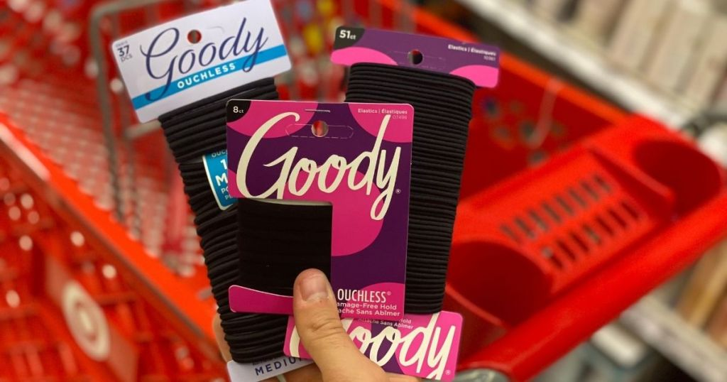 hand holding Goody hair items in front of Target cart