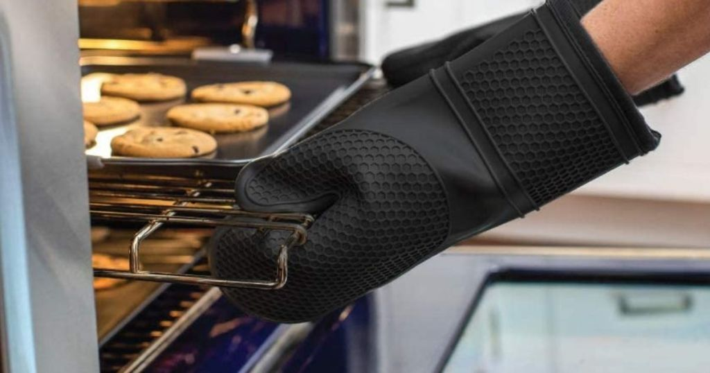hands grabbing a tray out of the oven