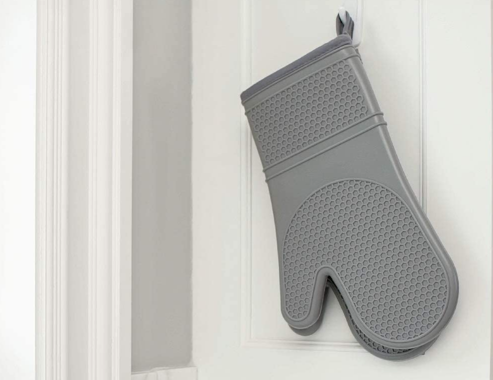 oven mitts hanging on a hook