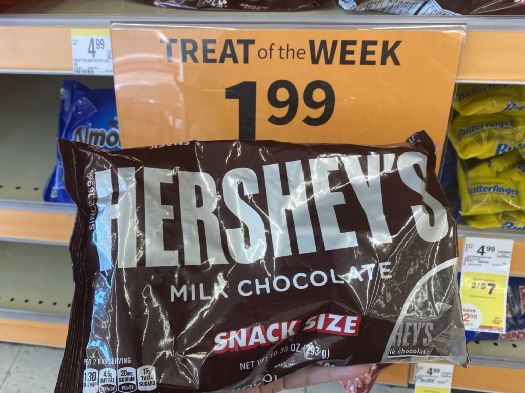 hand holding hershey's snack size candy bag