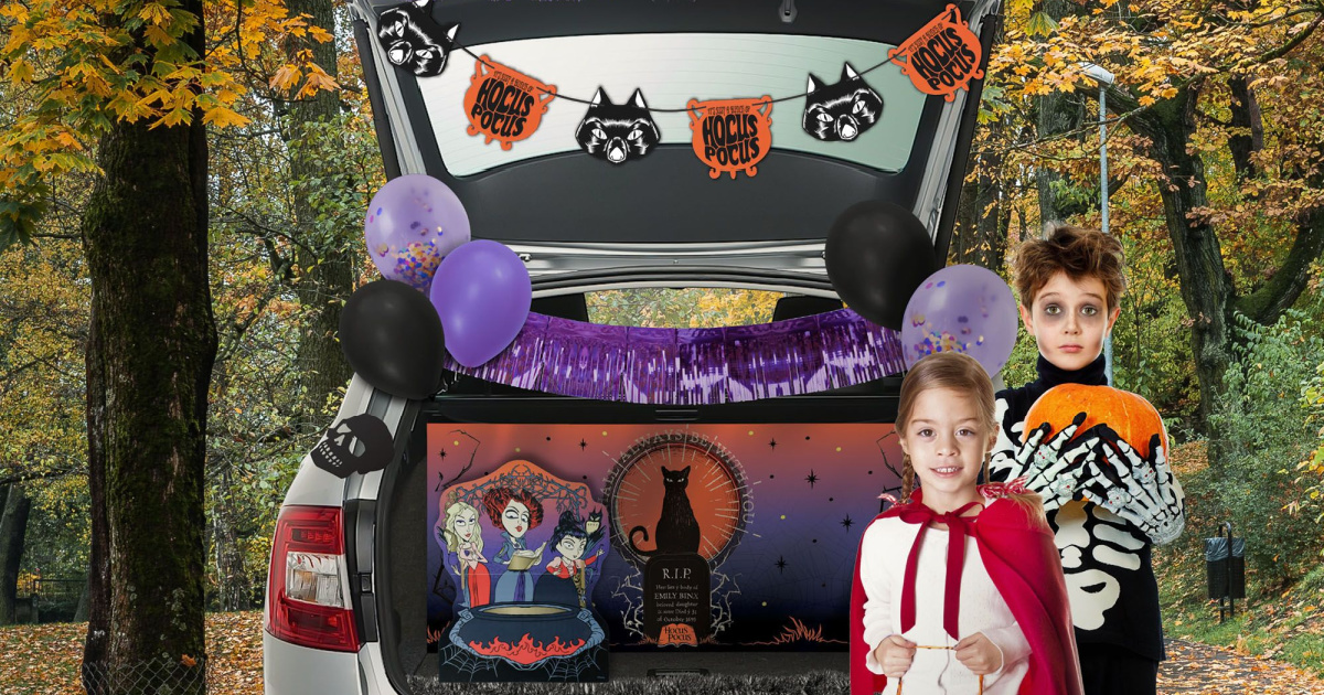 open trunk showcasing hocus pocus trunk or treat kit with kids standing next to it