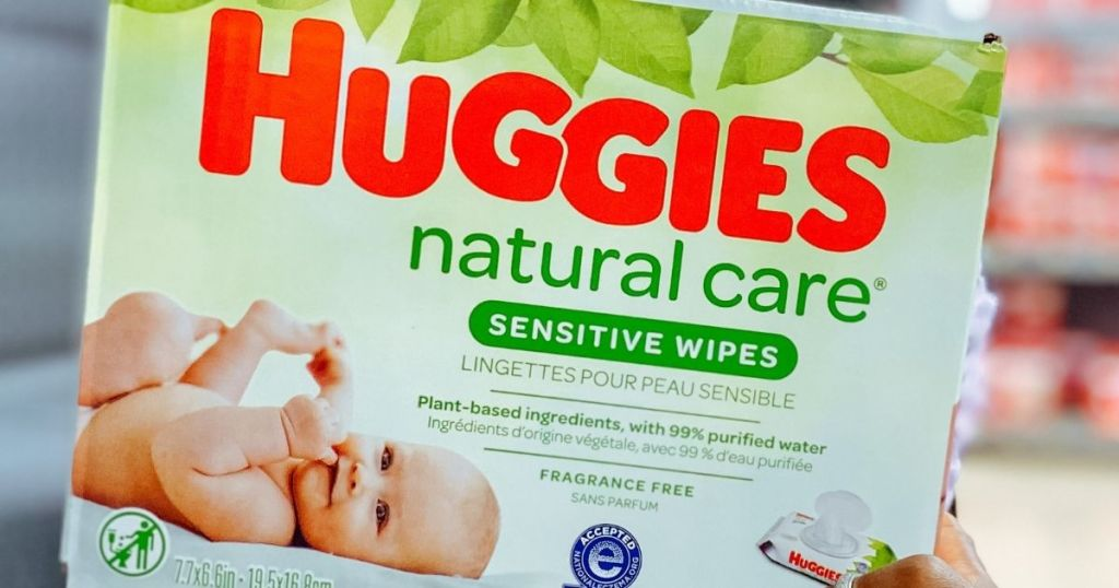 hand holding a box of Huggies Natural Care Wipes