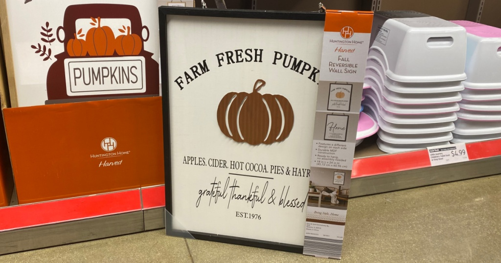 fall-themed reversible signs on display in-store