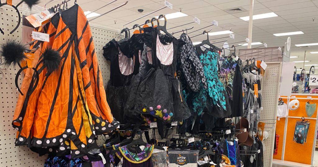 orange and black Halloween costume on racks