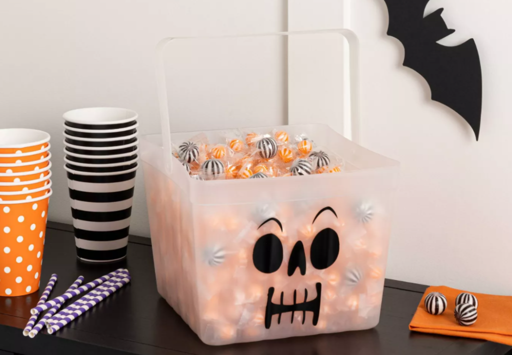 candy bucket and cups on a table