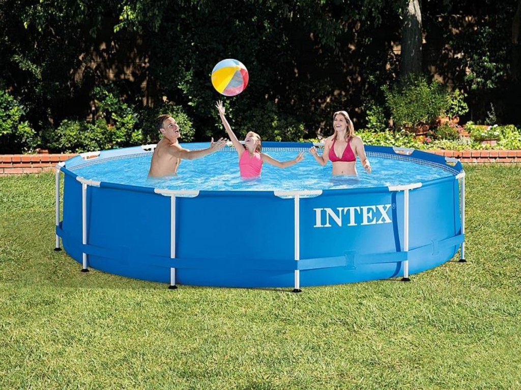 family swimming in intex 12x2.5' above ground pool