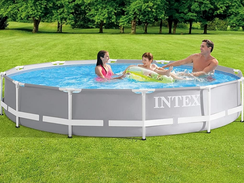 family swimming in intex 12x30 inch above ground pool