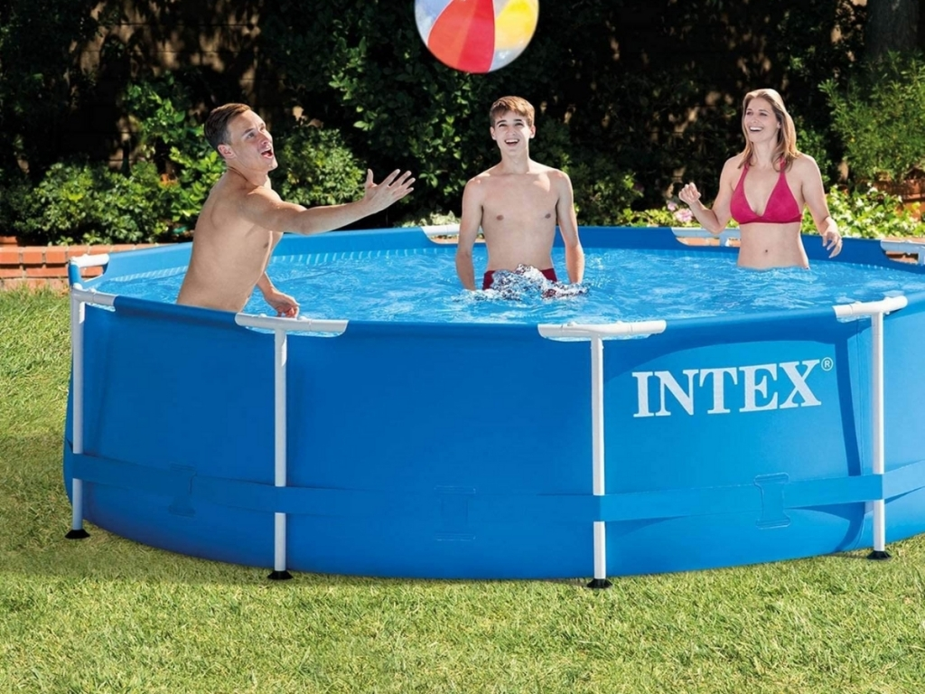 family playing in intex 10' round above ground pool